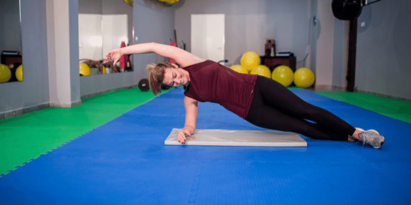 lying down exercises to lose belly fat(Side Plank With Twist)